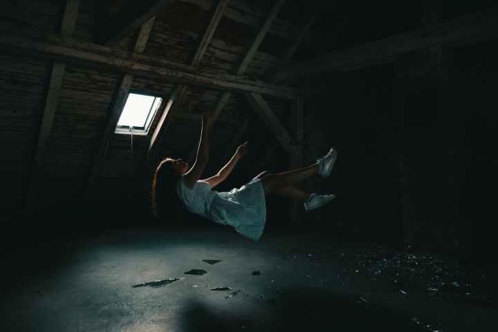 woman in white dress falling on gray concrete floor